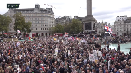 WATCH: London police slam woman to the ground during anti-lockdown protest in Trafalgar Square